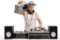 Angry elderly DJ with a boombox. Playing music on a turntable isolated on white background stock photos
