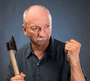 Angry elderly man with an ax Stock Photos