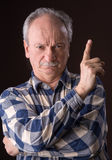 Angry elderly man pointing up Stock Images