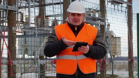 Angry Electrical Engineer with tablet PC in substation stock video footage