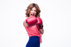 Angry elegant woman with boxing gloves fighting Royalty Free Stock Images