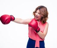 Angry elegant woman with boxing gloves fighting Royalty Free Stock Photo