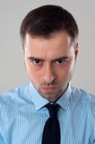 Angry emotion on face of business man Stock Photo