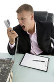 Angry employee shouting on phone. Against white background Stock Image