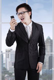 Angry entrepreneur yelling on his phone Royalty Free Stock Photography
