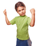Angry evil girl female child shows fists Stock Image