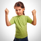 Angry evil girl shows fists experiencing anger and. Anger emotions Royalty Free Stock Photo