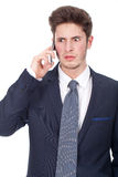 Angry executive man using cellphone Royalty Free Stock Photography