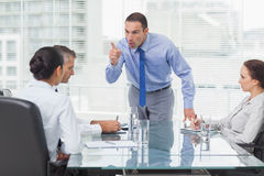 Angry executive pointing out his employee stock images