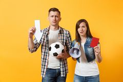 Angry expessive couple woman man football fans screaming, cheer up support team with soccer ball, down arrow, megaphone. Angry couple woman man football fans stock photos
