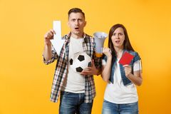 Angry expessive couple woman man football fans screaming, cheer up support team with soccer ball, down arrow, megaphone. Angry couple woman man football fans stock photo