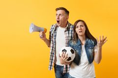 Angry expessive crazy couple, woman man football fans screaming, upset of loss, goal of favorite team with soccer ball stock images