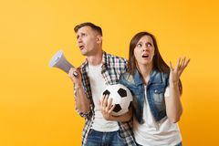 Angry expessive crazy couple, woman man football fans screaming, upset of loss, goal of favorite team with soccer ball stock photography