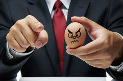 Angry expression on egg Stock Photos