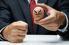 Angry expression on egg Royalty Free Stock Images