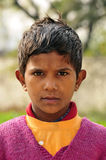 Angry expressions. Portrait of a poor indian child royalty free stock photo