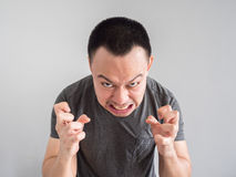Angry face of asian man portrait. Angry asian man portrait with funny mad face Stock Image