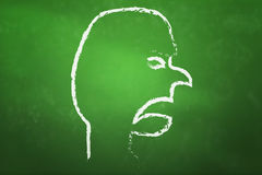 Angry Face on blackboard Stock Photo