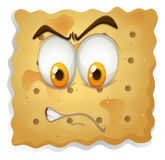 Angry face on cookie Royalty Free Stock Photos