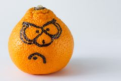 Angry face. Emotion faces on mandarins photoset. Angry face Royalty Free Stock Photography