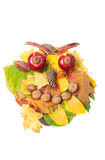 Angry face made of autumn fall leaves and fall decorations Stock Photo