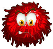 Angry face on red pom pom Stock Photography