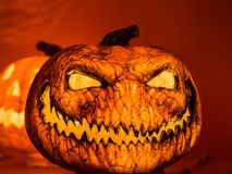The angry face with the sharp teeth of the orange scary pumpkin Royalty Free Stock Photography