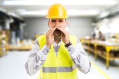 Angry factory manager yelling and shouting mad stock images
