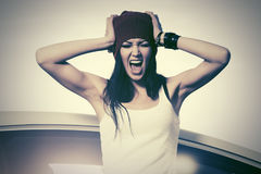 Angry fashion woman in tank top shouting beside a her car royalty free stock images