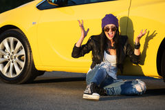 Angry fashionable woman sitting at the car Stock Photography