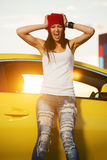 Angry young fashion woman standing by her car stock photography