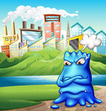 An angry fat blue monster in the city Stock Photo