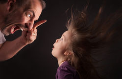 Angry Father with astonished daughter Stock Images