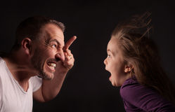 Angry Father with astonished daughter Royalty Free Stock Images