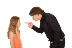 Angry father pointing finger at his child Stock Image
