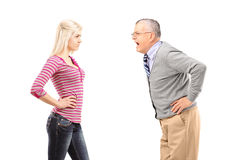 Angry father shouting at his daughter. Isolated on white background Stock Images