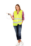 Angry female builder holding helmet Royalty Free Stock Photography
