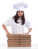 Angry female chef with boxes of pizza Stock Images