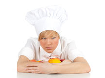 Angry female cook with fruits and vegetables Royalty Free Stock Photography