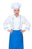 Angry female cook looking at camera Stock Photo