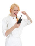 Angry female cook with phone and raised hand Royalty Free Stock Photography