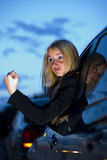 Angry female driver. Closeup of a female driver making an angry fisted gesture out of her window while driving Royalty Free Stock Photo