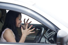 Angry female driver driving a car Royalty Free Stock Photography