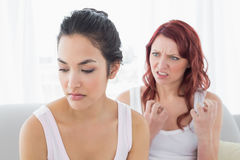 Angry female friends having an argument in living room Royalty Free Stock Photography