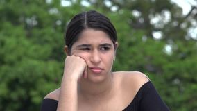 Angry Female Hispanic Teenager. A young female hispanic teen stock video footage