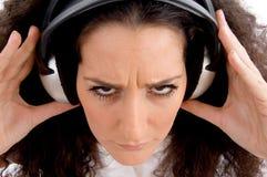 angry female listening music Στοκ εικόνες με δικαίωμα ελεύθερης χρήσης