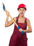 Angry female lumberer swinging huge ax Royalty Free Stock Image
