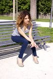 Angry female model waiting on bench. Young woman waiting angry on bench in a park Stock Images