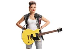 Angry female punker with an electric guitar. Isolated on white background stock photography