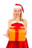 Angry female Santa with Christmas gift Stock Image